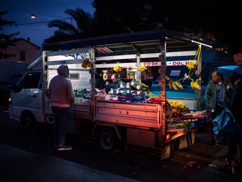 A truck selling fruit and vegetables on the street