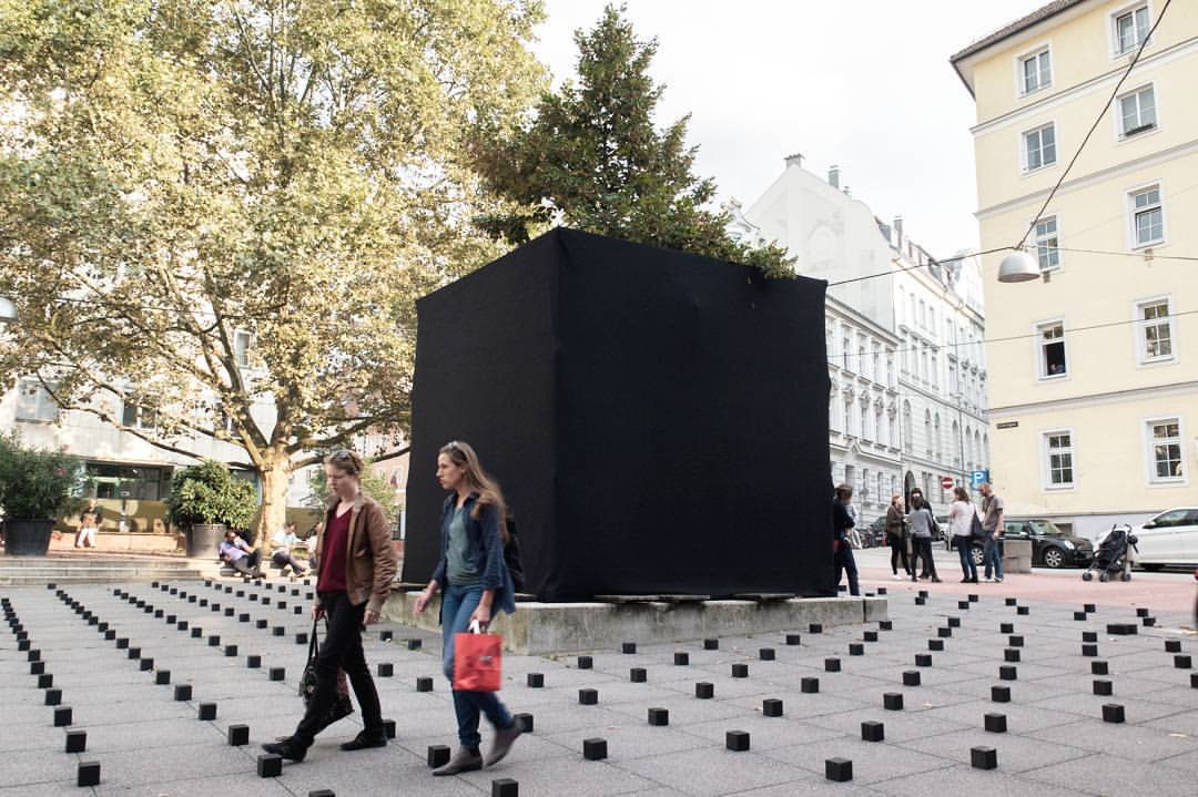 Black wooden box on public space